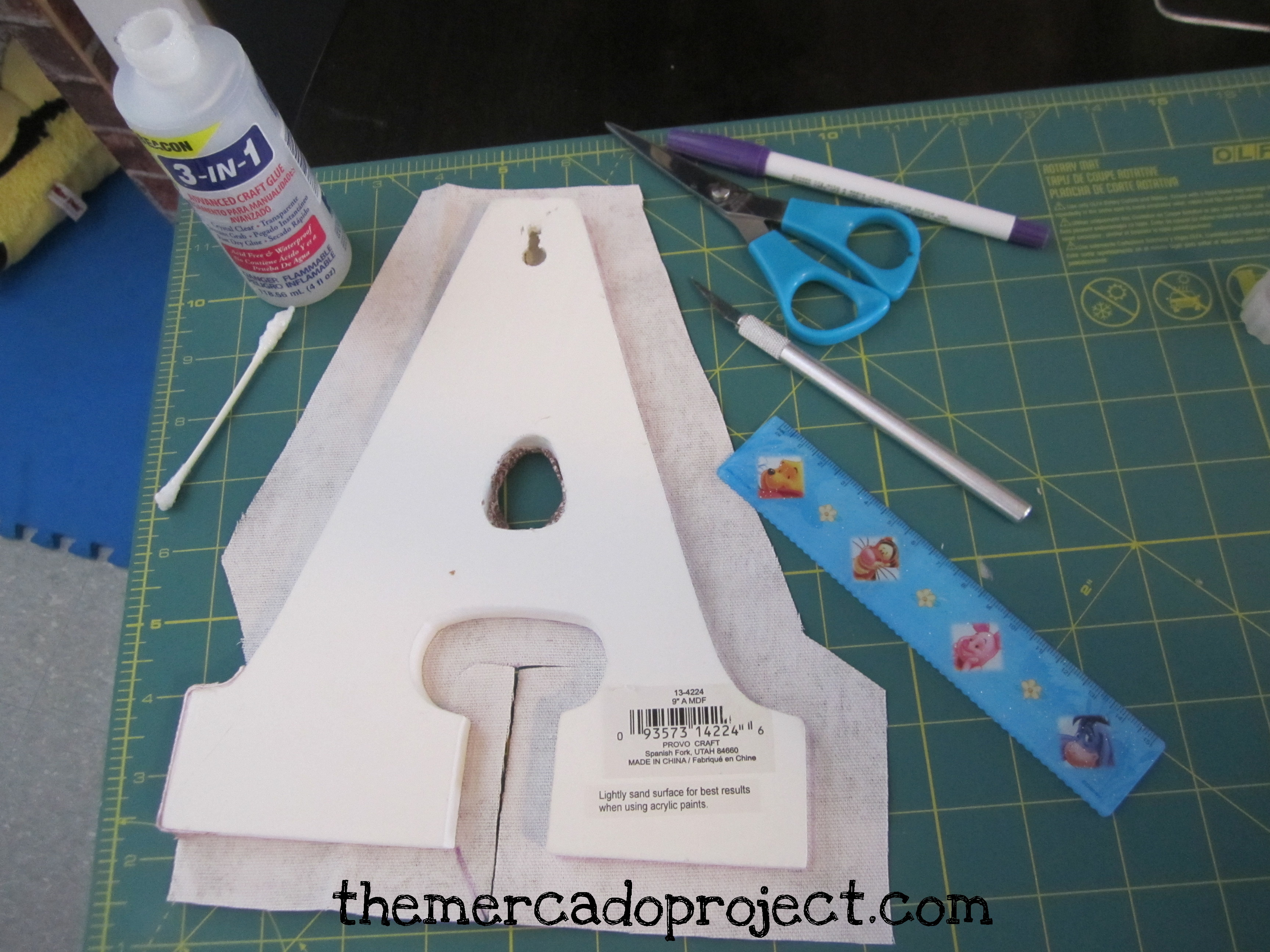 Diy fabric covered wooden letters themercadoproject for How to cover cardboard letters with fabric